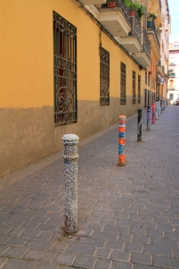 Coloured bollards in Malasana